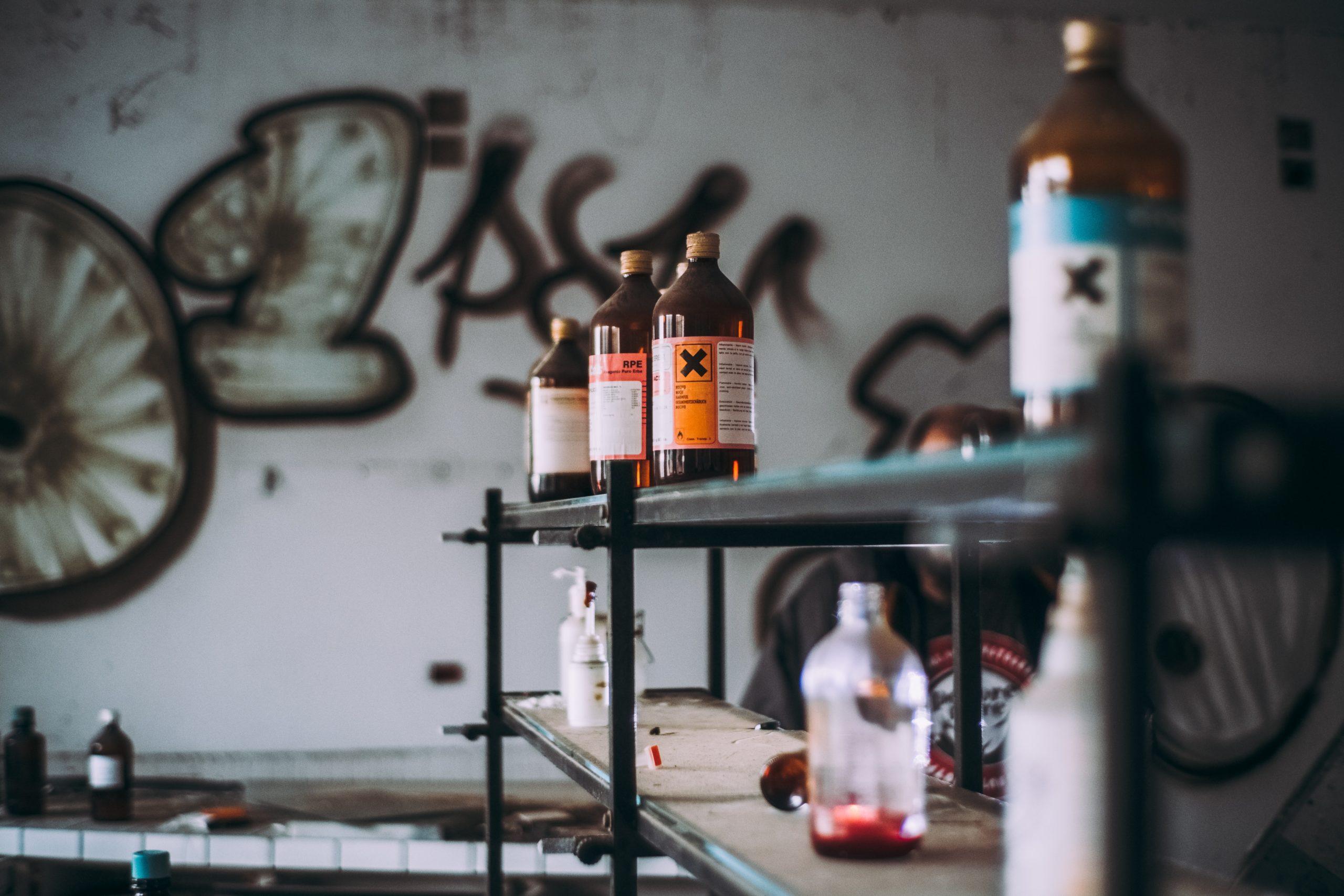 glass-bottles-on-shelf-1771809-scaled